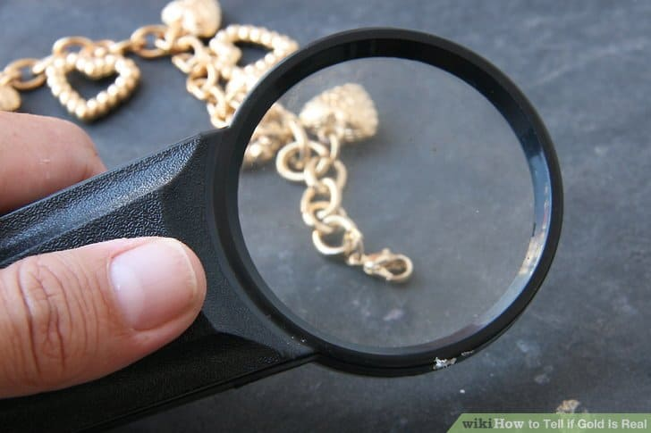 magnifying glass and gold jewerly