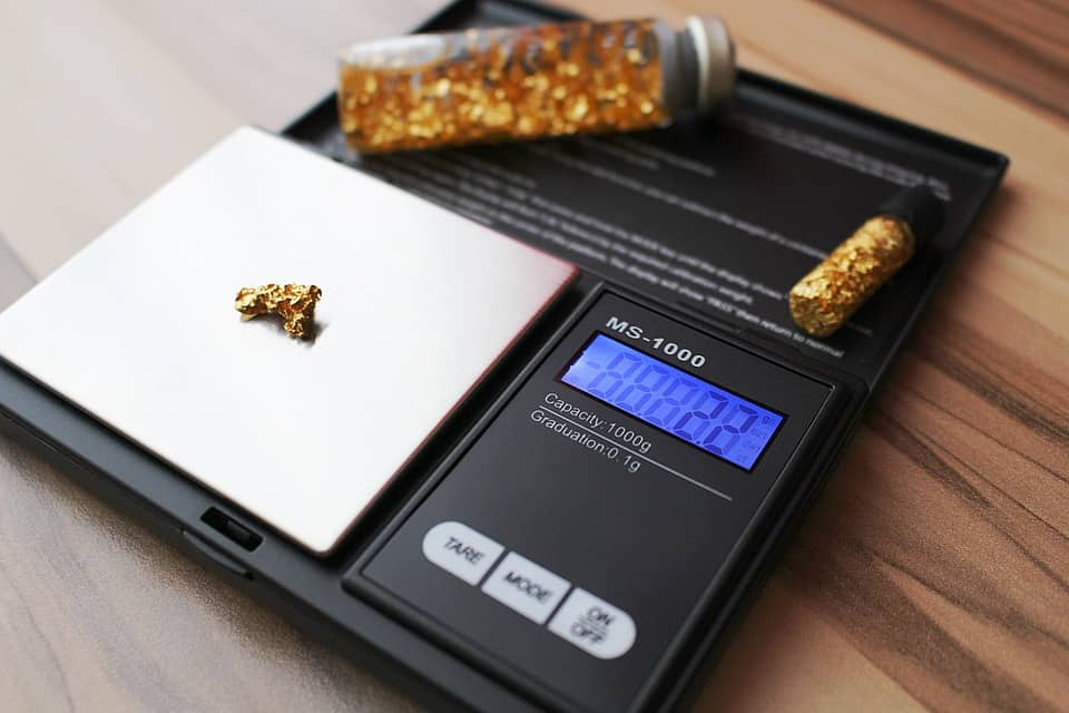 weighing scale and gold